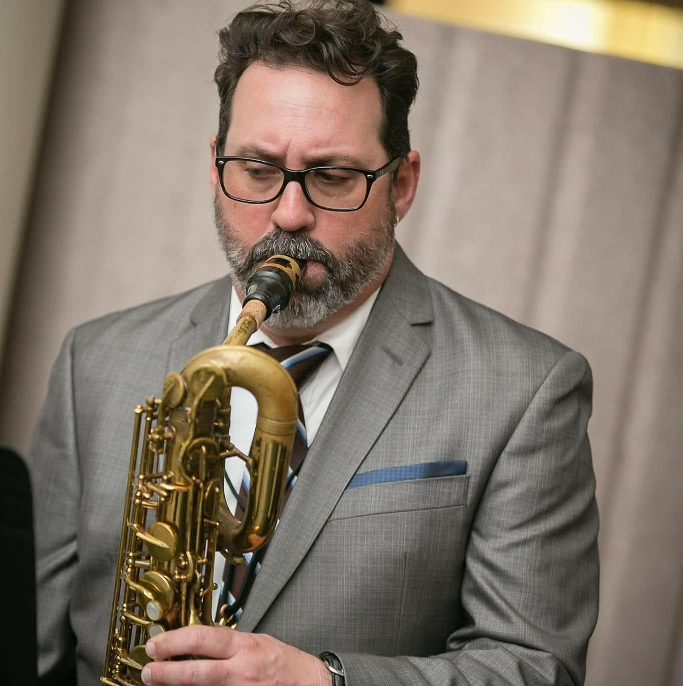 Dave Villa playing saxophone.