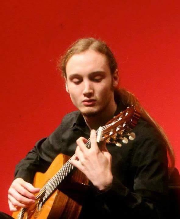 Evan Warwick playing guitar.
