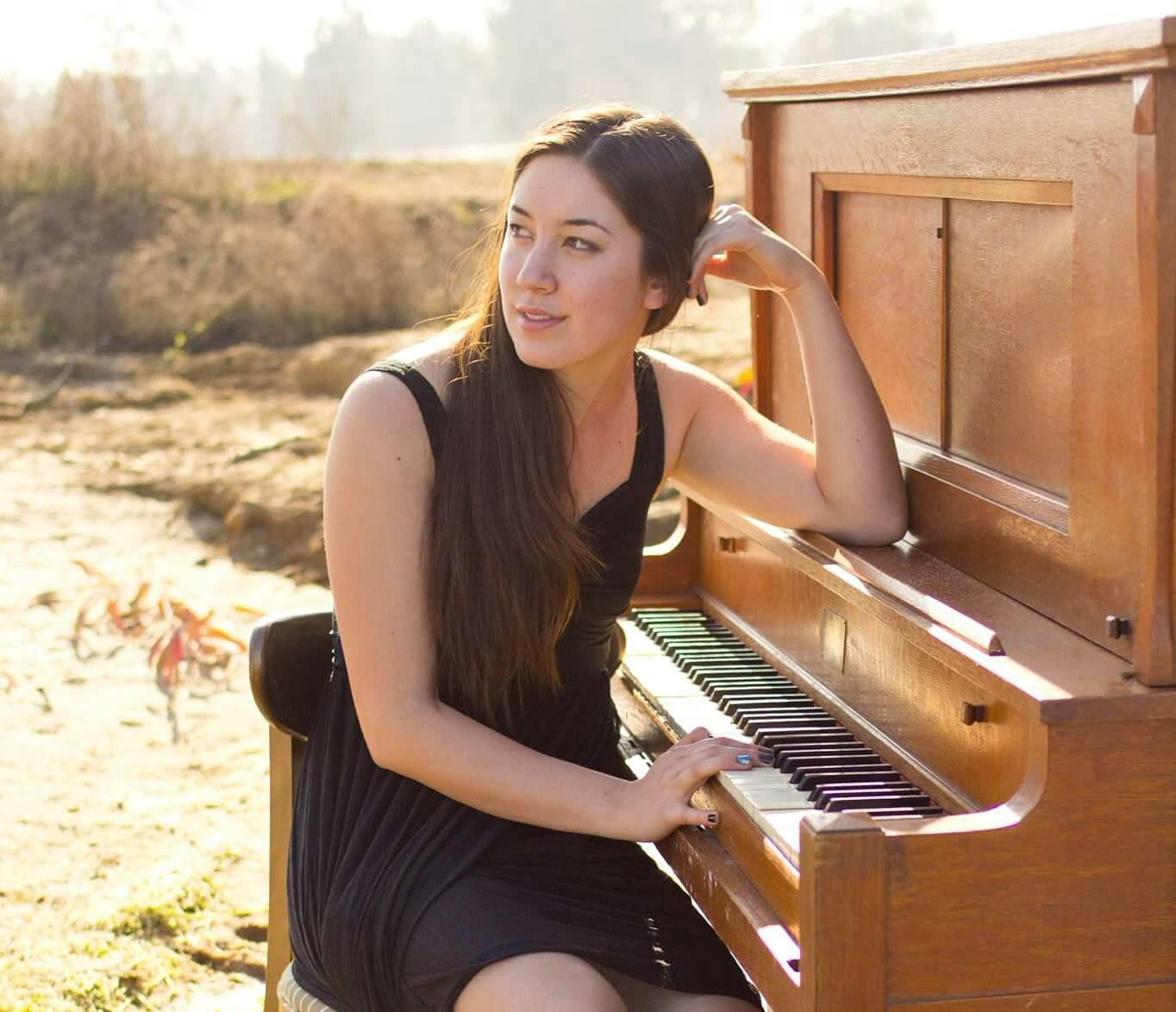 Jessica Igarashi with a piano.