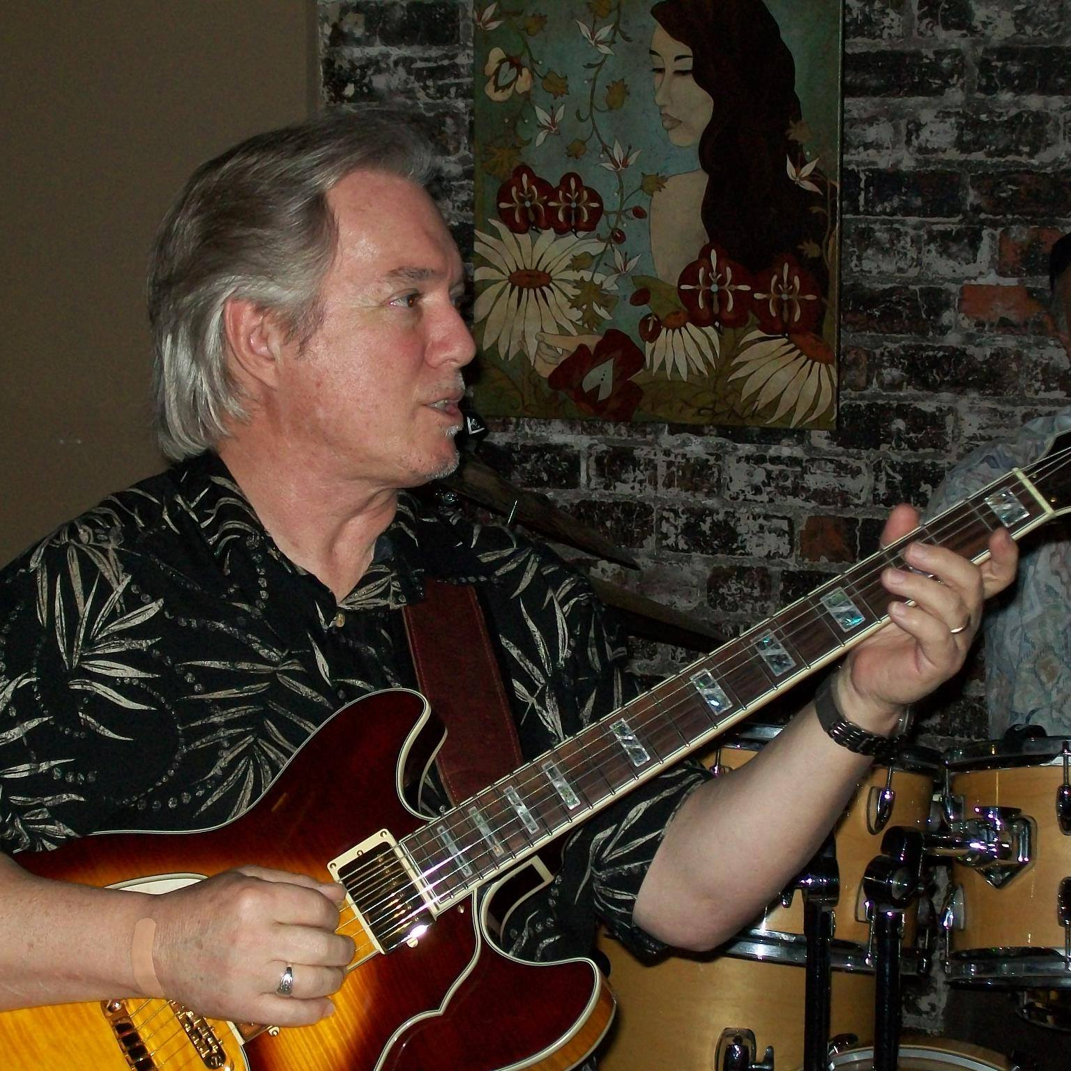 Larry Stewart playing guitar.