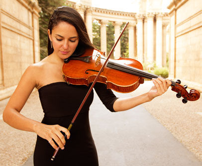 Margaret Gonzalez with a violin.