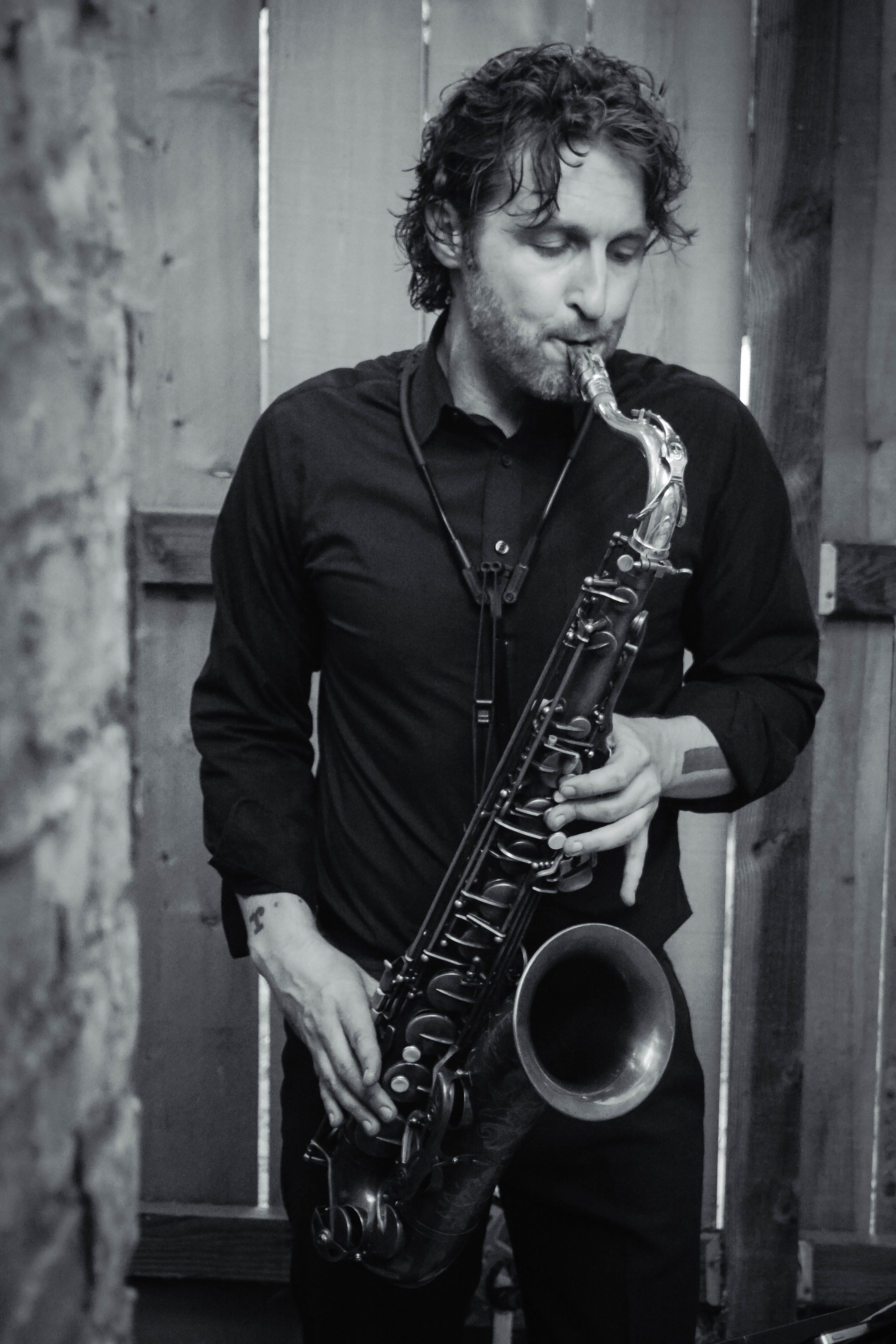 Tom Renner playing saxophone.